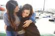 Spain, Barcelona, happy mother and daughter hugging each other near the harbour