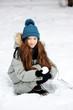 Funny kid girl having fun in beautiful winter park