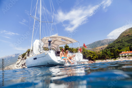 Tuinposter Zeilen couple yacht honeymoon sailing luxury cruise