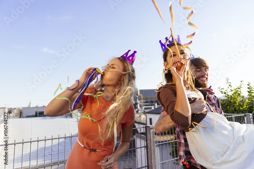 Young people having a party on rooftop terrace