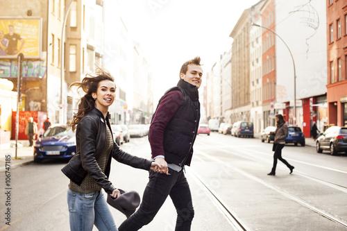 Keuken foto achterwand Berlijn Germany, Berlin, happy couple crossing a street