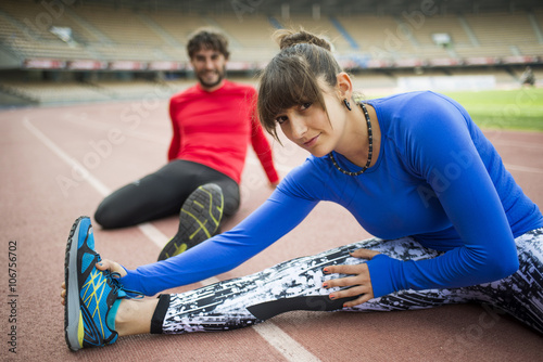Portrait of athletes training in stadium