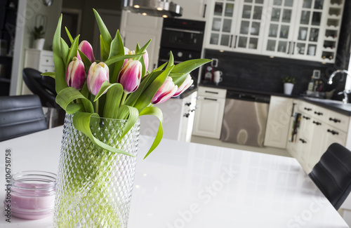 Tulips in a modern kitchen Canvas Print