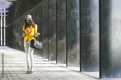 Spain,Catalunya, Barcelona, young modern woman with yellow jacket on the move Poster