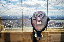 Tourist Binoculars At The Top Of The Empire State Building In New York