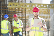 Construction worker using digital tablet in construction site