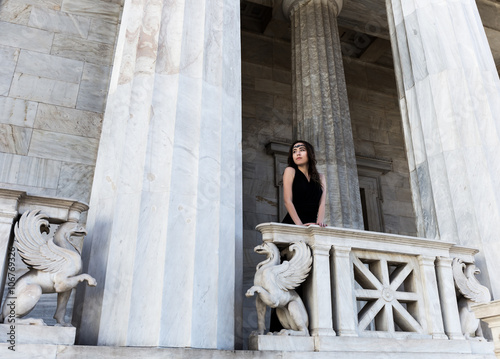young lady in black dress on stone balcony Wallpaper Mural