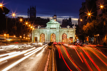 Traffic lights at Puerta de Alcala, Alcala Gate, a neo-classical monument in the Plaza de la Independencia, Independence Square, in Madrid, Spain.