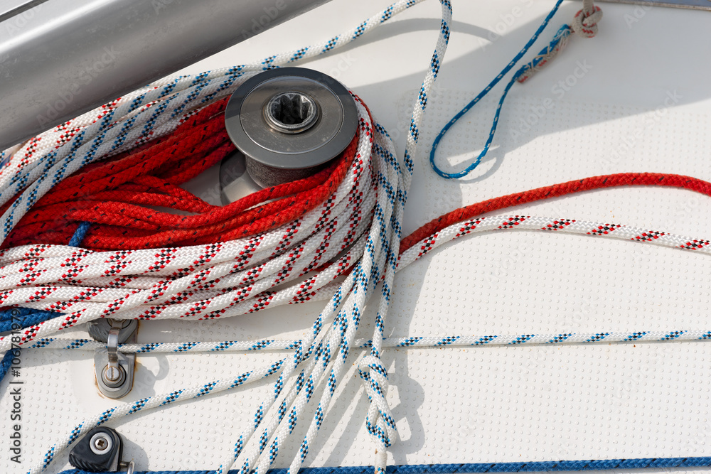 Winch with Ropes on a Sailboat / Detail of a sailboat deck with a ...