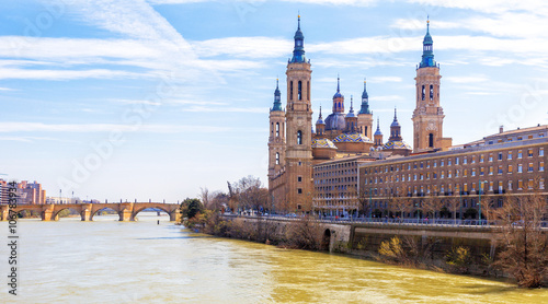Ancient stone bridge and Cathedral from Ebro river. Zaragoza, Ar