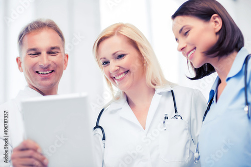 doctors looking at tablet pc Poster