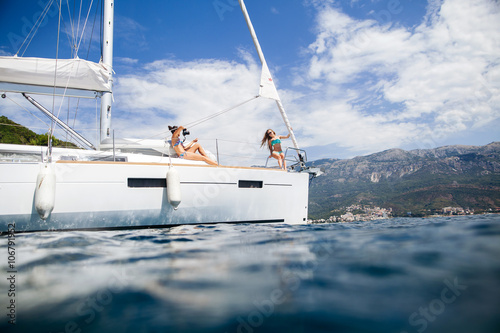 Photo Stands Caribbean girls yachting and photograph sea cruise vacation