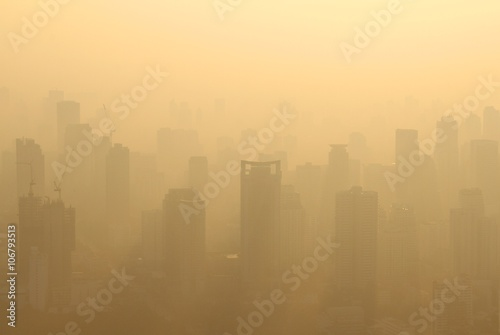 Buildings under construction with cranes in misty morning, Bangkok, Thailand Poster