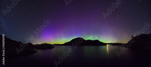 Foto auf Gartenposter Nordlicht panoramic view of colorful northern lights (Aurora Borealis) at fjord landscape, Norway, Europe