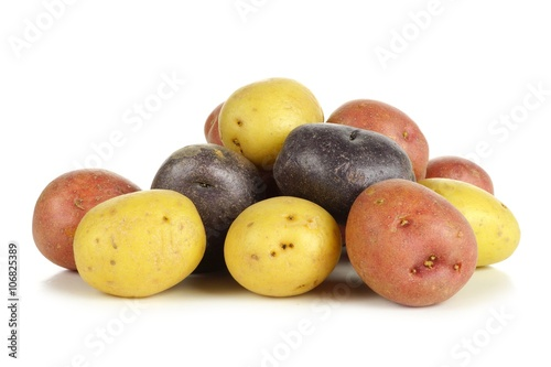 Fotografie, Obraz  Pile of colorful fresh little potatoes over a white background