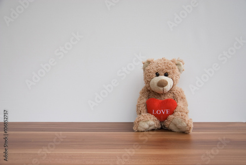obraz lub plakat Teddy bear with a red heart