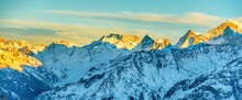 Panorama Of Mountains Peaks At Sunset
