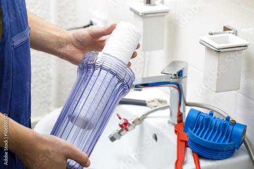 Fotografia, Obraz  plumber installing new water filtration system