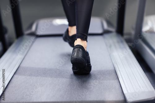 Legs on treadmill Fototapeta