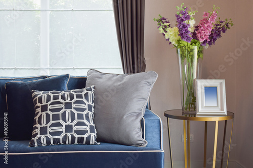 Fotografia, Obraz  Navy blue modern classic sofa and retro, gray and blue pillows with a lovely orc