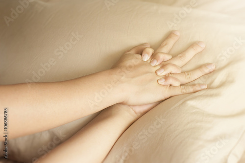Photo  Close up hands of a couple having sex on a bed