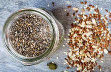 Mixed Seeds And A Jar Of Chia Seeds