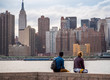 Young Man and woman looking at New York Skyline
