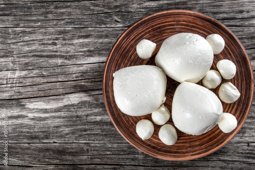 Mozzarella balls on clay dish, top view