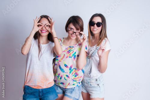 Studio Lifestyle Portrait Of Three Best Friends Hipster Girls