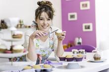 Woman Decorating Cupcake