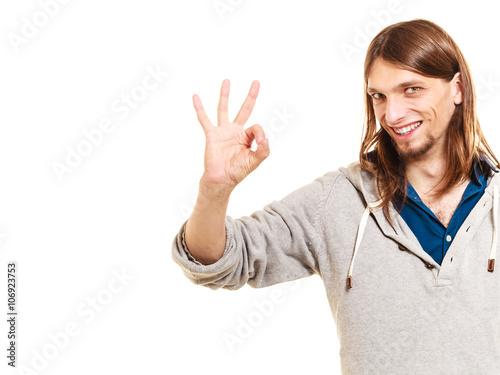 Valokuva  Man showing ok fine alright gesture.