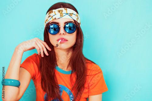Fotografie, Obraz  Beautiful hippy girl portrait smoking and wearing sunglasses