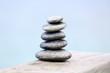 Stack of spa stones on wooden bridge
