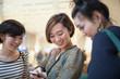 Three young Japanese women talking