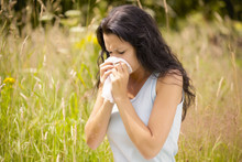 Girl Wiping Nose With Tissue