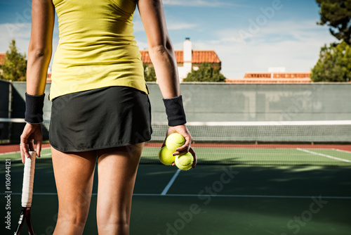 Female tennis player holding balls Poster