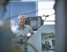 Lathe Operator Working In Factory, Portrait