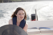 Teenager Driving Speedboat