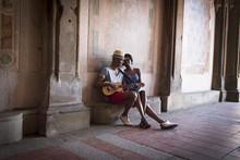 Young Couple With Mandolin In Bethesda Terrace Arcade, Central Park, New York City, USA