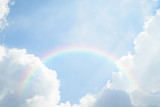 Fototapeta Rainbow - Blue sky cloud with rainbow