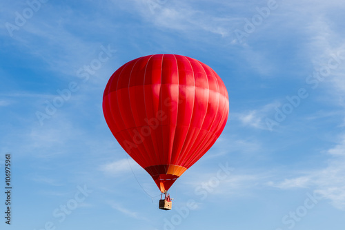 Hot air balloon ride in blue skies
