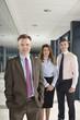 Portrait of business colleagues in corridor