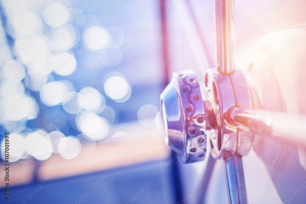 Fototapety, obrazy: Yachting detail - Rudder on deck / board with water and sun reflection in background