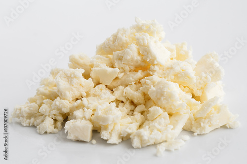 Crumbled white feta cheese isolated on white.