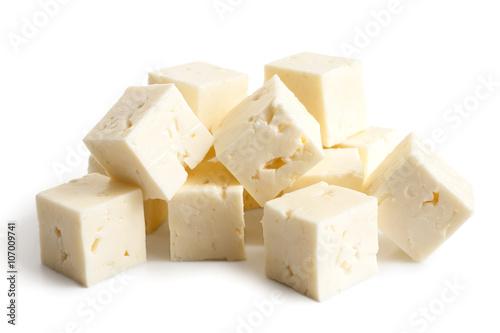 Fototapeta Square cubes of feta cheese isolated on white. obraz