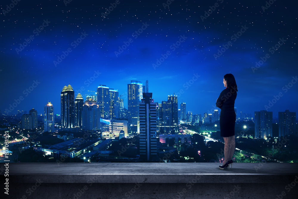 Fototapety, obrazy: Asian business person standing on the rooftop