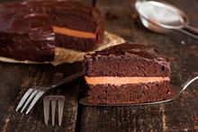 Piece Of Chocolate Cake On A Dark Wooden Background