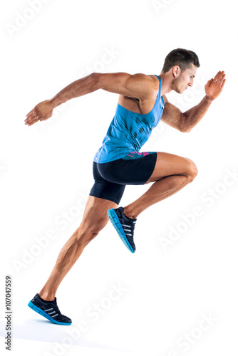 Fotografía  Full length portrait of a fitness man running isolated on a white background