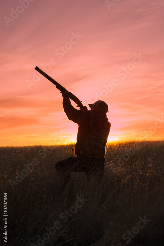 Fotografie, Obraz  Hunter Shooting at Sunrise