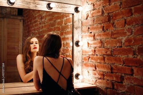Fotografie, Obraz  Seductive Woman Looking at Mirror